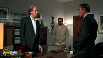 A still #6 from Hands of Steel (1986) with John Saxon and Andrea Coppola