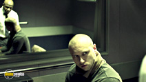 A still #9 from Offender (2012) with English Frank