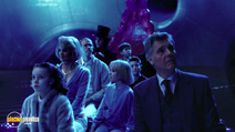 A still #15 from Charlie and the Chocolate Factory with Missi Pyle, Johnny Depp, Annasophia Robb, Jordan Fry, Julia Winter and James Fox