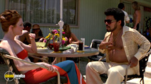 A still #7 from Boogie Nights with Julianne Moore and Luis Guzmán
