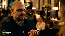 A still #13 from Gambit with Stanley Tucci