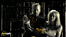 A still #2 from Sin City with Bruce Willis and Jessica Alba