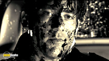 A still #7 from Sin City with Clive Owen