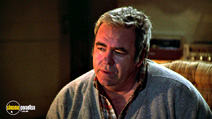 A still #8 from Gremlins (1984) with Hoyt Axton