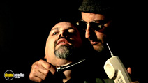 A still #18 from Leon with Jean Reno and Frank Senger