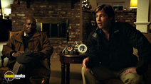 A still #6 from Moneyball with Brent Jennings and Brad Pitt