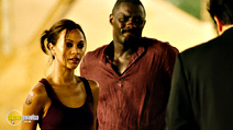 A still #6 from The Losers with Zoe Saldana and Idris Elba