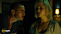 A still #5 from No One Lives (2012) with Derek Magyar and Adelaide Clemens