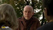 A still #3 from Warm Bodies with John Malkovich