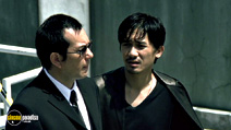 A still #14 from Infernal Affairs 1 with Tony Chiu Wai Leung and Anthony Chau-Sang Wong