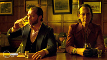 A still #5 from Dom Hemingway with Jude Law and Richard E. Grant