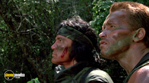 A still #3 from Predator (1987) with Arnold Schwarzenegger and Sonny Landham