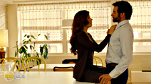 A still #4 from American Hustle with Bradley Cooper and Amy Adams