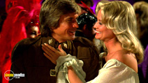 A still #7 from Battlestar Galactica (1978) with Dirk Benedict and Laurette Spang