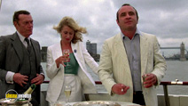 A still #7 from The Long Good Friday with Bob Hoskins and Eddie Constantine