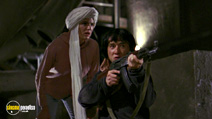 A still #5 from Operation Condor: Armour of God 2 (1991) with Jackie Chan and Eva Cobo