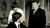 A still #20 from The Beatles: A Hard Day's Night with Norman Rossington and George Harrison