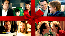 A still #19 from Love Actually with Andrew Lincoln, Hugh Grant, Liam Neeson, Emma Thompson, Keira Knightley, Martine McCutcheon and Thomas Brodie-Sangster