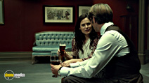 A still #9 from Hannibal: Series 1 with Caroline Dhavernas and Mads Mikkelsen