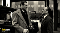 A still #17 from Schindler's List with Ben Kingsley and Liam Neeson