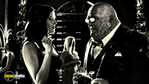 A still #15 from Sin City: A Dame to Kill For with Stacy Keach and Eva Green