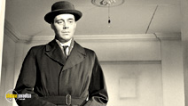 A still #21 from The Servant with Dirk Bogarde