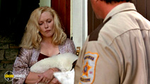 A still #14 from Cop Land with Sylvester Stallone and Cathy Moriarty