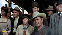 A still #28 from True Grit with Dennis Hopper, Robert Duvall, James Westerfield, Kim Darby, Strother Martin, Alfred Ryder, John Fiedler, Donald Woods, John Doucette and H.W. Gim