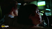 A still #16 from American Graffiti with Ron Howard and Cindy Williams