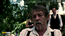 A still #19 from The Skeleton Key with Peter Sarsgaard and John Hurt