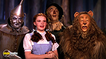 A still #19 from The Wizard of Oz with Judy Garland, Ray Bolger, Jack Haley and Bert Lahr