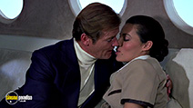 A still #49 from James Bond: Moonraker with Roger Moore and Leila Shenna