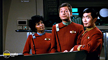 A still #27 from Star Trek 2: The Wrath of Khan with Nichelle Nichols, George Takei and Deforest Kelley