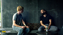 A still #21 from Ex Machina with Domhnall Gleeson and Oscar Isaac