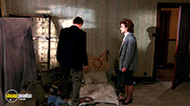 A still #14 from Hellraiser with Andrew Robinson and Clare Higgins