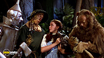A still #12 from The Wizard of Oz with Judy Garland, Ray Bolger, Jack Haley and Bert Lahr