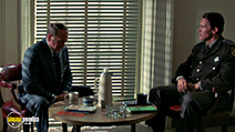A still #32 from Raw Deal with Arnold Schwarzenegger and Darren McGavin