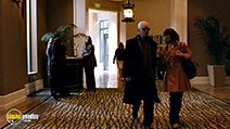 A still #18 from Halloween 2 with Caroline Williams and Malcolm McDowell