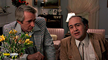 A still #3 from Terms of Endearment (1983) with Danny DeVito and Norman Bennett
