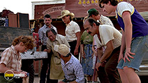 A still #26 from Tremors with Kevin Bacon, Victor Wong, Fred Ward, Reba McEntire, Tony Genaro and Finn Carter