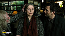 A still #48 from Children of Men with Michael Caine, Clive Owen and Rita Davies