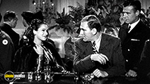 A still #25 from The Blue Dahlia (1946) with William Bendix and Doris Dowling