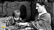 A still #2 from The Kid (1921) with Charles Chaplin and Jackie Coogan