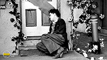 A still #3 from The Kid (1921) with Charles Chaplin