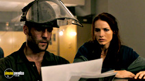 A still #19 from The Bank Job with Jason Statham and Saffron Burrows
