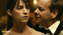 A still #2 from Melancholia (2011) with Kiefer Sutherland and Charlotte Gainsbourg