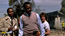 A still #6 from Lethal Weapon (1987) with Mel Gibson, Grand L. Bush and Danny Glover