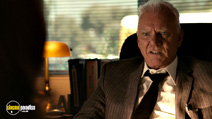 A still #5 from Easy A with Malcolm McDowell