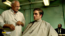 A still #9 from Cosmopolis with George Touliatos and Robert Pattinson