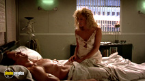 A still #18 from Total Recall (1990) with Arnold Schwarzenegger and Sharon Stone